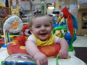 Rosie laughing in exersaucer